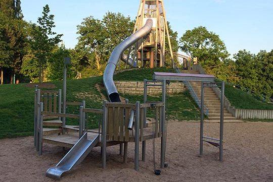 large slides in playground free stock image