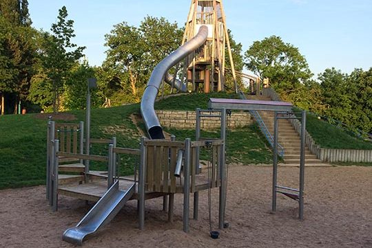 large slides in playground free stock image