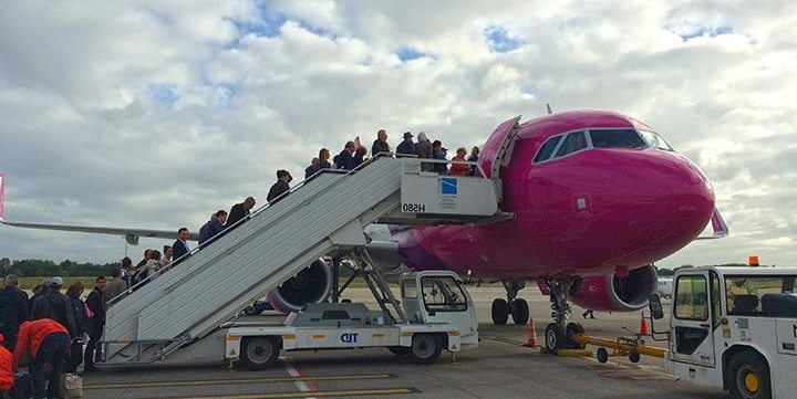 people boarding airplane free stock image