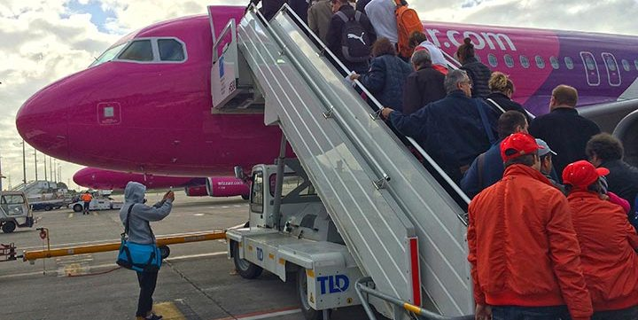 people boarding plane free stock image