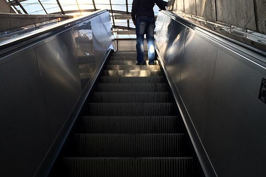 man on escalators free stock image