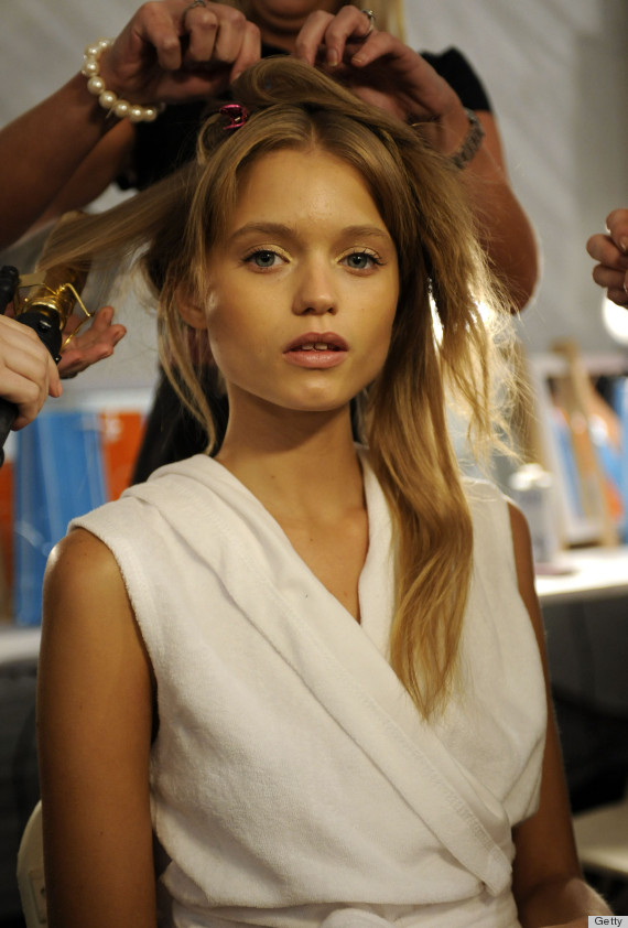 NEW YORK - SEPTEMBER 14: Model Abbey Lee Kershaw backstage for Carlos Miele Spring 2010 during Mercedes-Benz Fashion Week at Bryant Park on September 14, 2009 in New York City. (Photo by Arun Nevader/FilmMagic)