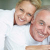 Closeup portrait of a smiling couple having fun together at home