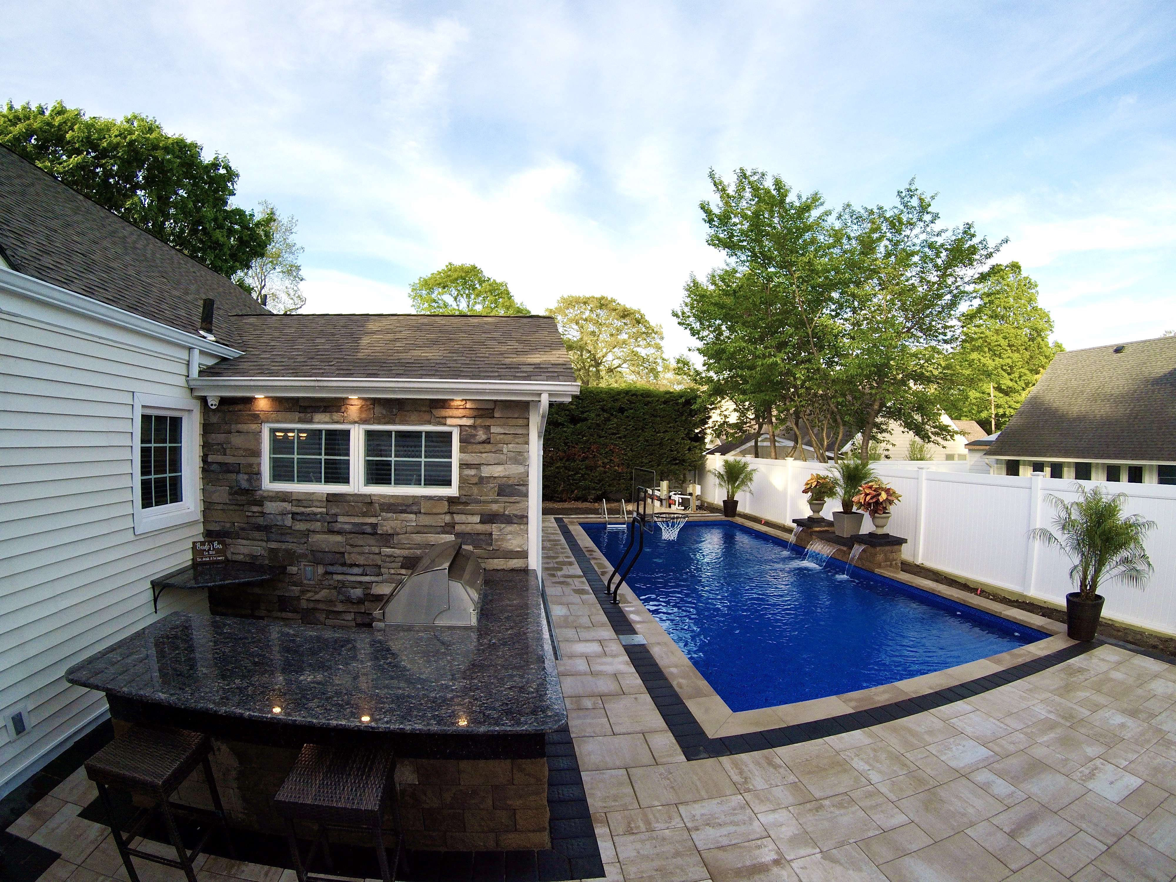 pool patio with waterfall and kitchen