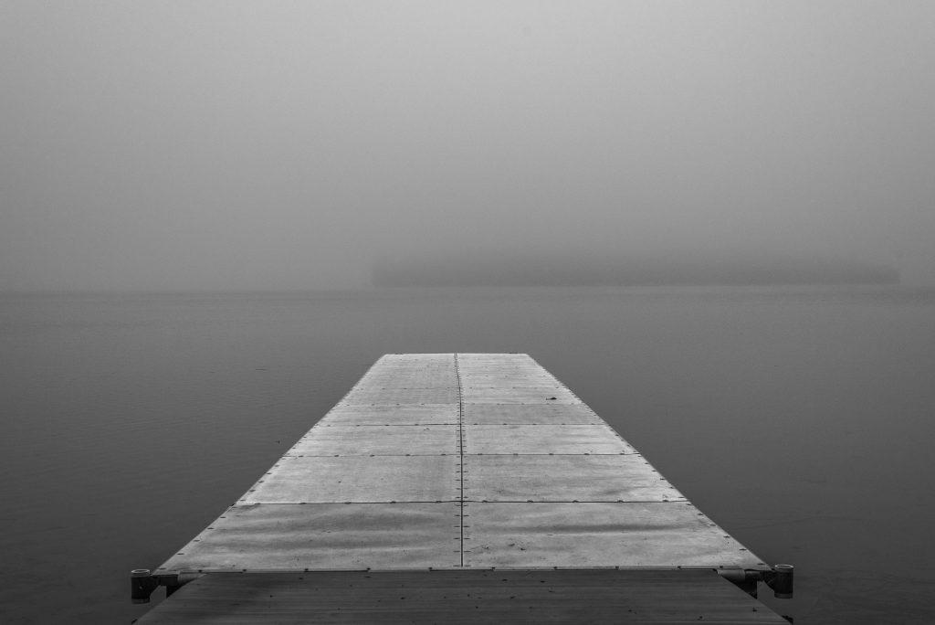 Boat Dock On A Fog Covered Lake