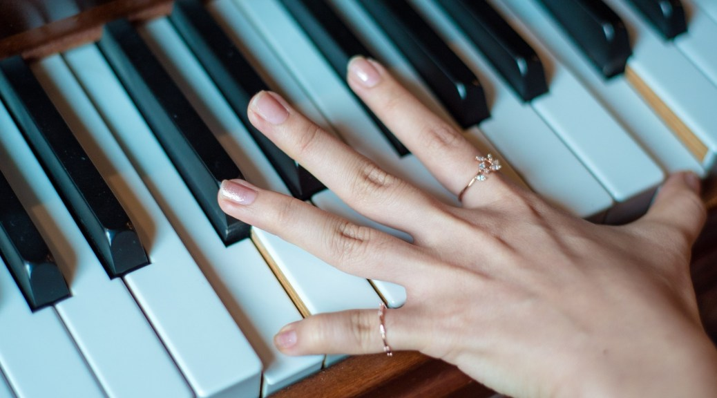 Naked Piano Player Hand