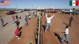 #1 Residents Of Naco, Arizona And Naco, Mexico Play Volleyball Match Over Fence Between USA And Mexico