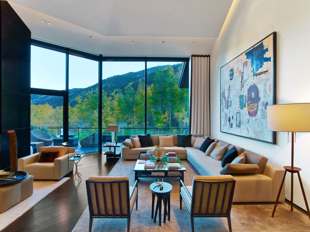 Aspen Art House Using warm finishes and a monochromatic palette  the interior is inviting  and comfortable  16  tall panels of glass provide views to the distant
