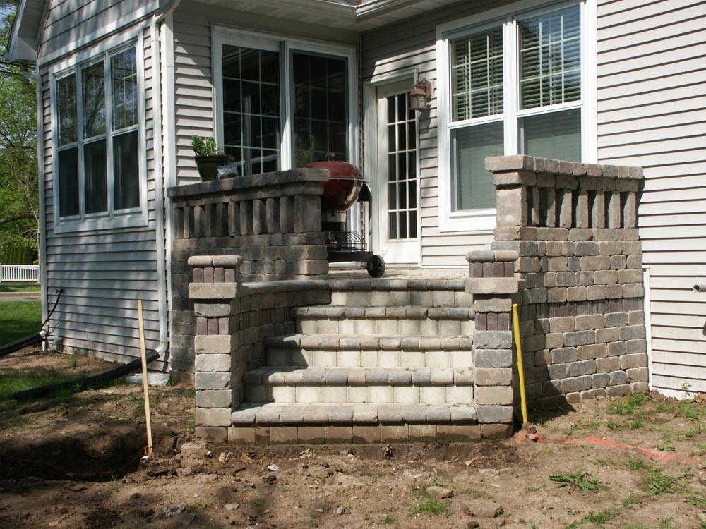 design of a raised paver patio