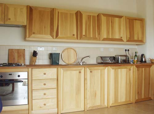Self catering holiday cottage Sunset barn's hand made wooden kitchen.