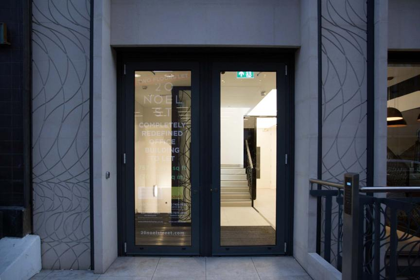 Portland Stone faced external stone facade including carved stone columns: 15mm Portland Stone on 30mm Piracell©.
