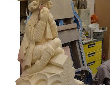 Big Issue vendor joins grotesques on York Minster