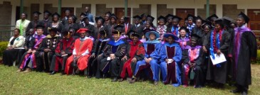Ceremony participants, lecturers and graduates. Ryan is seated near the right hand edge, in the second row.