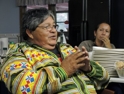 "Danny Billie of the Independent Traditional Seminole Nation, based in Florida points out how real forests ""mean life to The People, but Ge trees mean death."" Photo: PhotoLangelle.org"