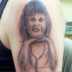 worst-baby-girl-tattoo-on-biceps