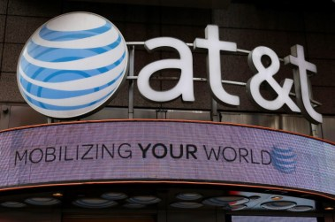 Signage for an AT&T store is seen in New York October 29, 2014. AT&T Inc has made a bid for Yahoo Inc's internet business, Bloomberg reported on Wednesday, citing people familiar with the matter. REUTERS/Shannon Stapleton/File Photo