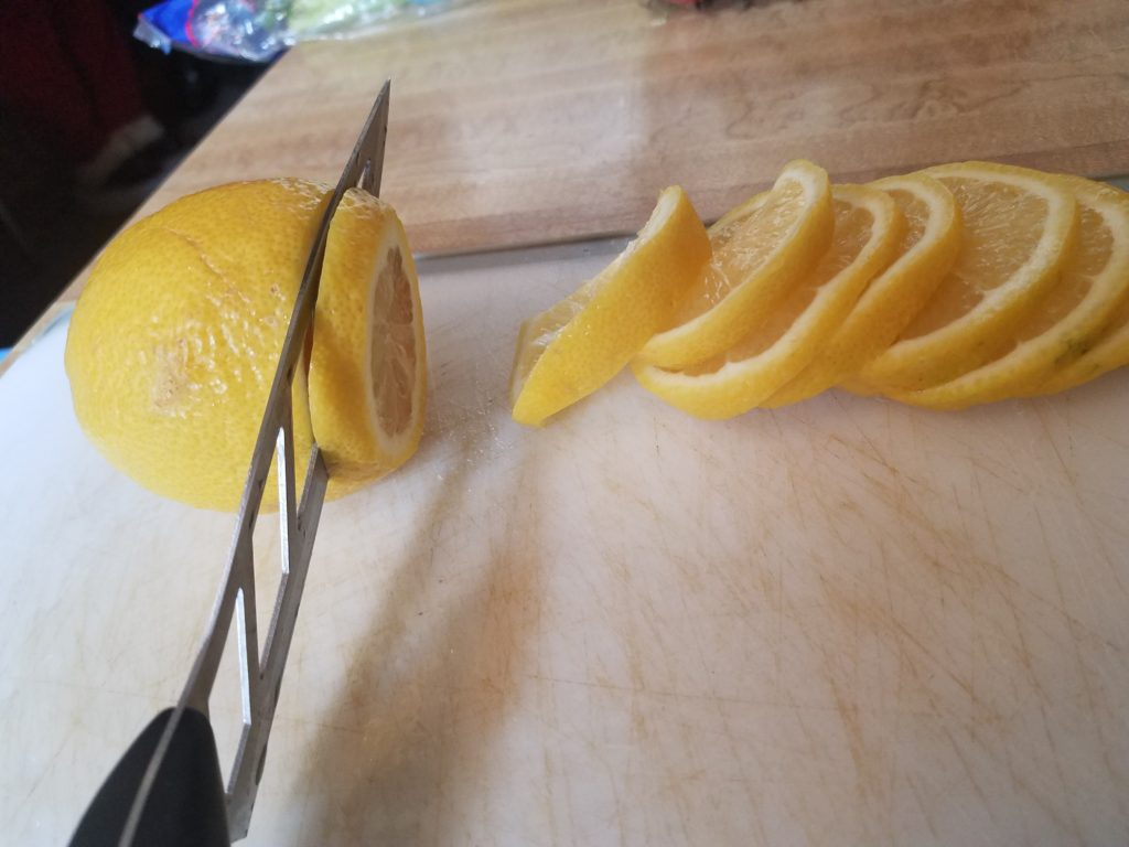 A knife slicing through a lemon. Meal Prep brings success and weight loss.