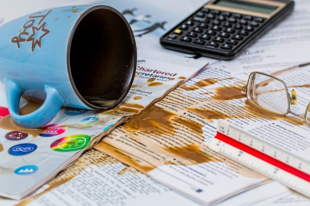 Coffee spilled over important papers with glasses and calculator nearby. How old habits creeped back in, and I failed myself. Getting Back on Track with Weight Loss, How to Lose Weight, Weight Loss Tricks, Diet