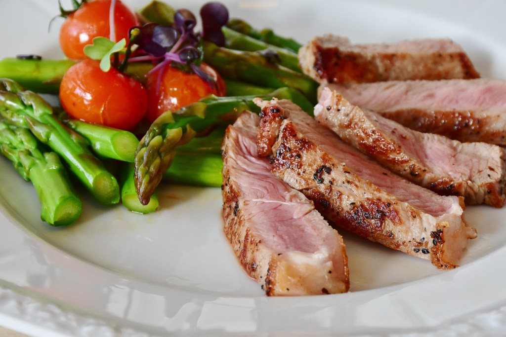 Lamb sliced up with asparagus and tomatoes. How to automate your meals to eliminate overwhelm