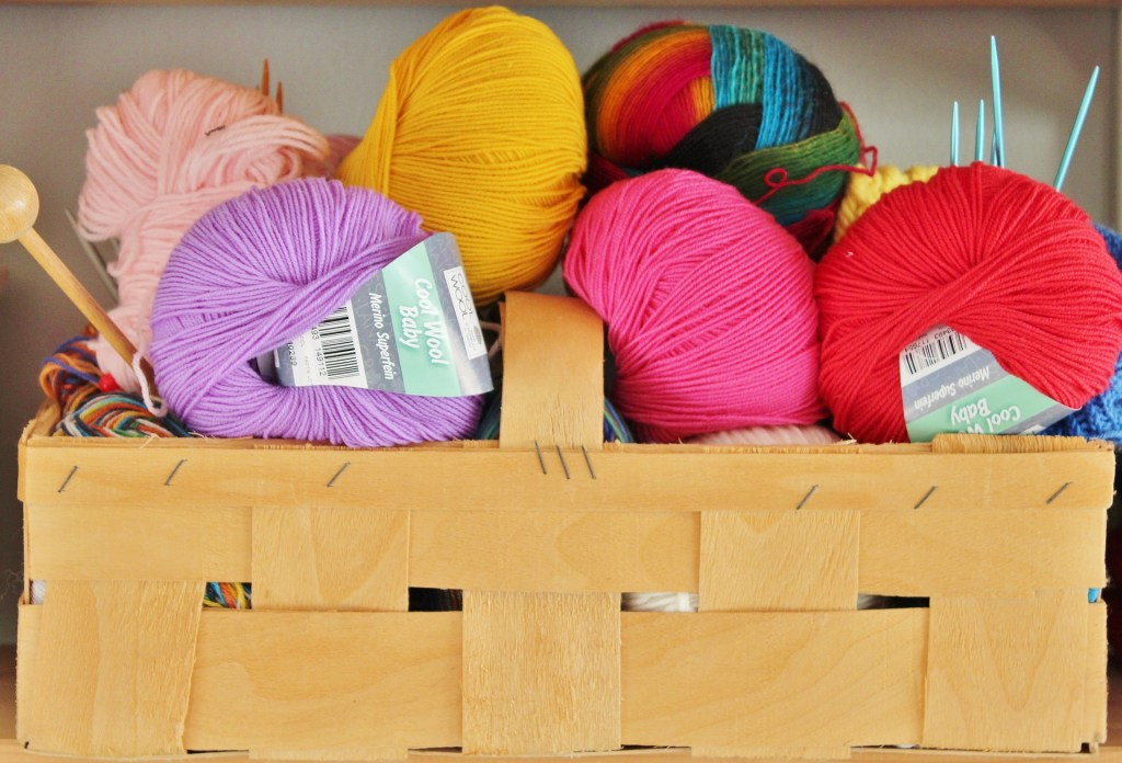 Brown carrying box with spools of brightly colored yarn. Embrace Hobbies to Lose Weight | Honing in on Things We Already Enjoy