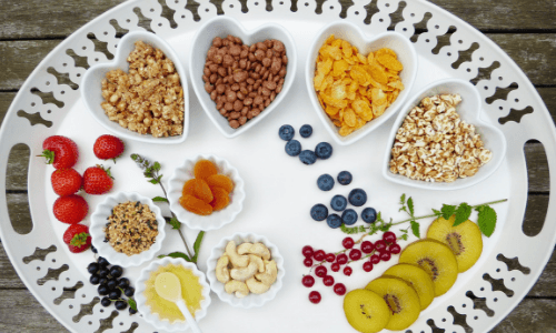 A platter with small portions of heart-healthy ingredients like strawberries, nuts, grains, and kiwi. Regular Bariatric Diet: Post-Surgery | Your New Normal Starts Now