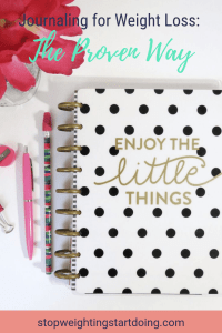 A black and white polka dot journal with the words Enjoy the Little things on a desk next to flowers and writing utensils Journaling for Weight Loss | The Proven Way to Journal for Weight Loss | Pinterest Graphic