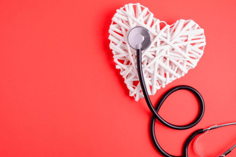 A heart made of white straws with a black stethoscope on a red background. Your Cardiac Clearance for Bariatric Surgery | What to Expect at Your Appointment. | Featured Image