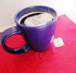Peppermint tea in a blue mug on a red placement. Clear liquid diet: Post bariatric surgery