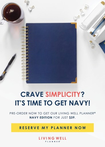 A Navy Living Well Planner on a desk with a pen. Using a Planner to Boost Your Weight Loss | A Living Well Planner Review | Ad Image