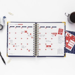 A Navy blue Living Well Planner opened to a monthly spread. Using a Planner to Boost Your Weight Loss | A Living Well Planner Review |