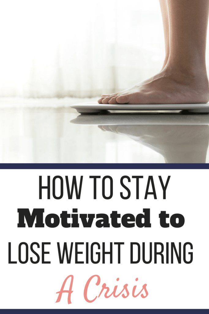 A person standing on a scale to weigh themselves. | How to Stay Motivated to Lose Weight During a Crisis | Murphy's Coming | Image | how to stay motivated on a diet, motivation