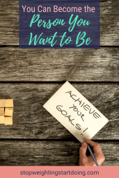A wooden plank witha notebook and a person writing Achieve Your Goals on it. | You Can Become the Person You Want to Be | 6 Steps to Get Started | Image | Act Like the Person You Want to Become