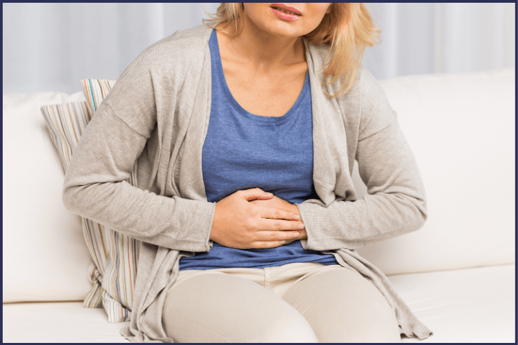 A woman grasping her stomach in pain. | How to Prevent Dumping Syndrome with Gastric Sleeve | Prevention Tips | Graphic | Dumping Syndrome Treatment, Late Dumping Syndrome