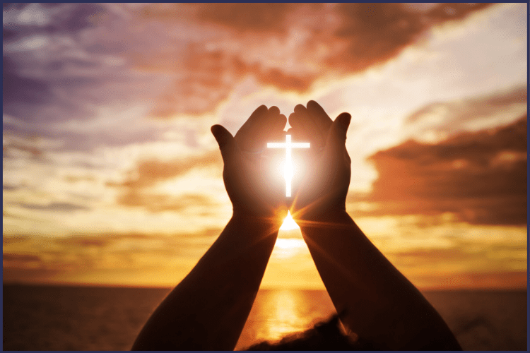 Two hands cupped together against a sunset sky over water. A bright white cross shines in the palm of the hands. | How I Found My Way Back to God Through Weight Loss | A Child of God | Image | Coming back to God after falling away