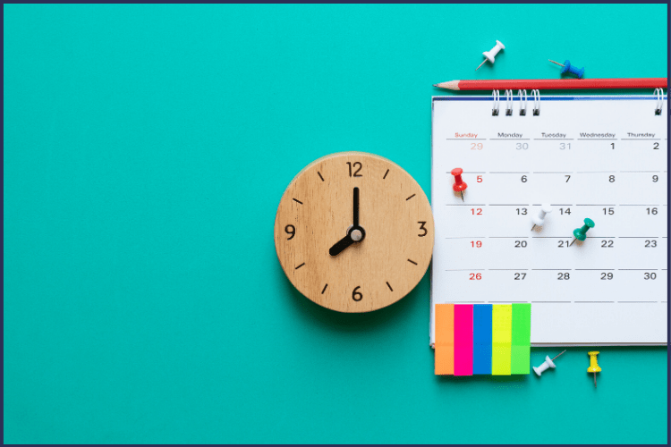A clock, calendar, tacks, red pencil, and colored tabs on a ocean blue background. | You Have Your Bariatric Surgery Date, Now What? | 9 Steps to Take! | Image | Bariatric Surgery Timeline, Gastric Bypass
