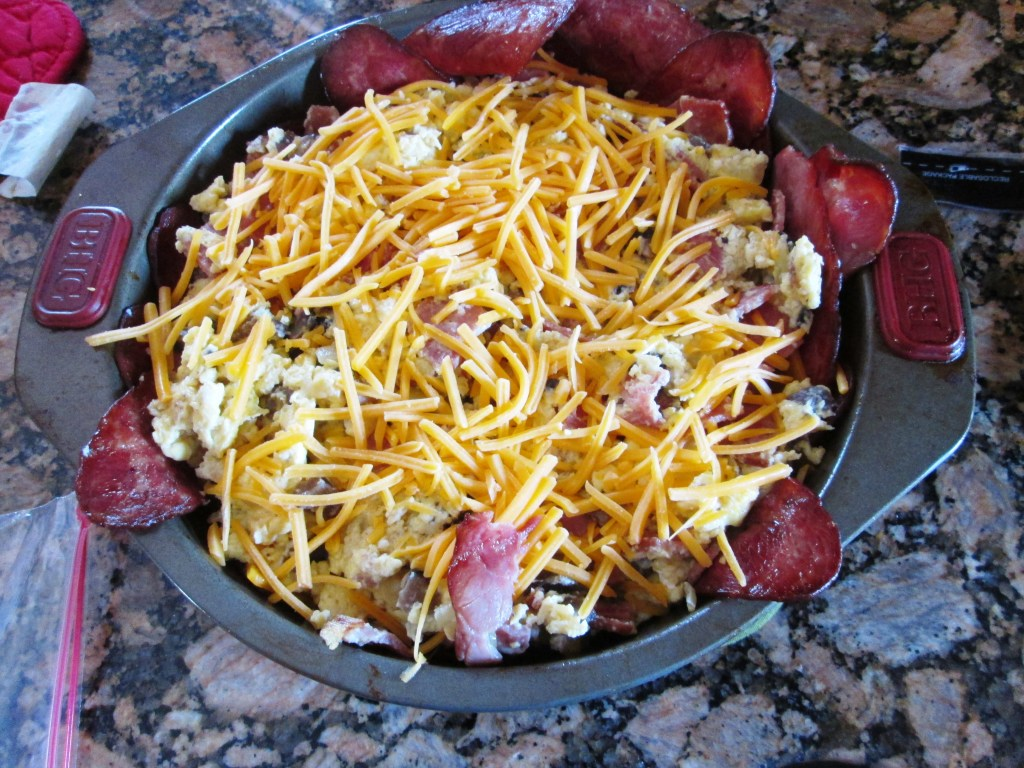 Cheddar cheese on top of a turkey bacon, egg, and cheese pie. This Turkey Bacon, Egg and Cheese Pie Will Blow Your Mind!   Bariatric   Image   turkey bacon calories, breakfast pie