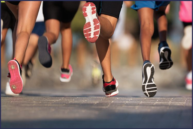 The legs of runners in a race. | How to Make Running Fun with Couch to 5k | 7 Easy Ways | Image | make running fun app, enjoy the run, Couch to 5k review
