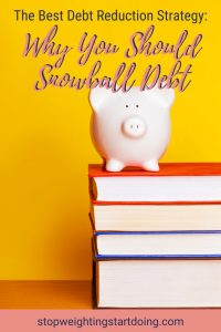 A baby pink piggy bank sitting on top of a pile of large textbooks with a bright yellow background. | Why You Should Snowball Debt - The Best Debt Reduction Strategy | Graphic | Debt snowball spreadsheet, snowball debt payoff, dave ramsey baby steps