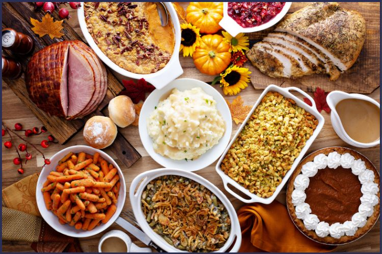 A bountiful Thanksgiving day feast. Avoid Overindulging on Thanksgiving This Year | Get the Planner | Thanksgiving, turkey day plan, strategies, overeating