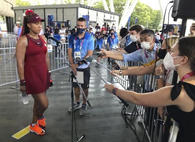 Naomi Osaka, of Japan, speaks with journalists after defeating China's Zheng Saisai during the tennis competition at the 2020 Summer Olympics, Sunday, July 25, 2021, in Tokyo, Japan. (AP Photo/Andrew Dampf)