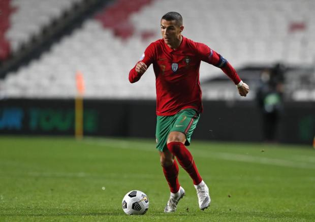 FILE - In this Saturday, Nov. 14, 2020 file photo, Portugal's Cristiano Ronaldo runs with the ball during the UEFA Nations League soccer match between Portugal and France at the Luz stadium in Lisbon. With a chance to become the all-time top scorer with a national team, Cristiano Ronaldo will highlight the list of top players at this year's European Championship. Others who could make an impact include Kylian Mbappé, Robert Lewandowski, Kevin De Bruyne and Harry Kane. (AP Photo/Armando Franca, File)