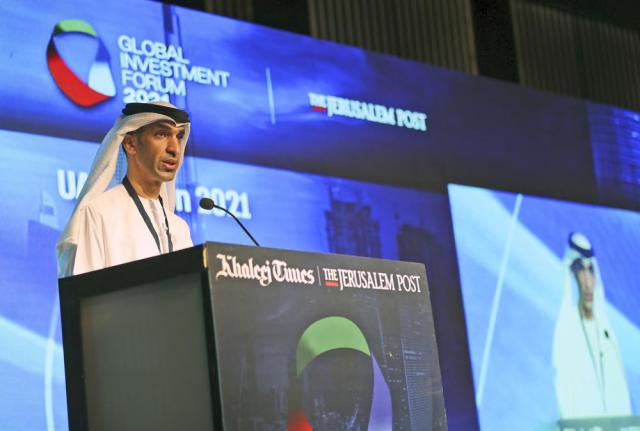 Dr. Thani bin Ahmed Al Zeyoudi, Minister of State for Foreign Trade at UAE Economy Ministry, talks during the Global Investment Forum in Dubai, United Arab Emirates, Wednesday, June 2, 2021. At the luxurious Armani hotel inside the world's tallest skyscraper in Dubai, Israelis in kippas and Emiratis in long white robes and kanduras gathered Wednesday to discuss investment opportunities aimed at making the most of deepening ties nine months after the two countries agreed to formalize relations.(AP Photo/Kamran Jebreili)