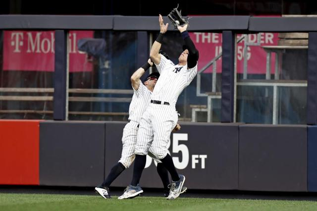 New York Yankees right fielder Aaron Judge, right, makes a catch in front of Brett Gardner on a ball hit by Minnesota Twins' Miguel Sano during the 10th inning of a baseball game on Monday, Sept. 13, 2021, in New York. (AP Photo/Adam Hunger)
