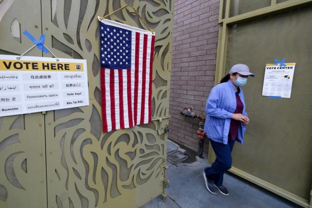 A voter leaves after casting her ballot at the Lincoln Park Senior Center in Los Angeles, Tuesday, Sept. 14, 2021. The recall election that could remove California Democratic Gov. Gavin Newsom is coming to an end. Voting concludes Tuesday in the rare, late-summer election that has emerged as a national battlefront on issues from COVID-19 restrictions to climate change. (AP Photo/Ringo H.W. Chiu)