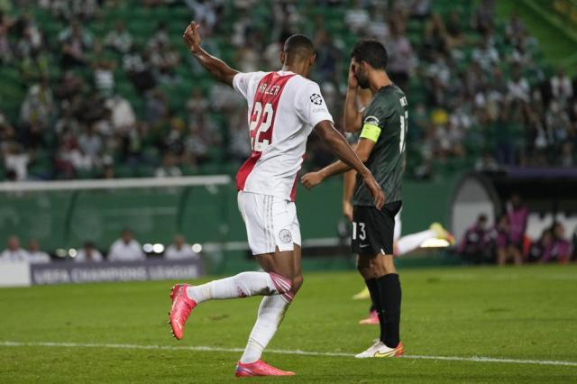 Ajax's Sebastien Haller, left, celebrates after scoring his side's second goal during a Champions League, Group C soccer match between Sporting CP and Ajax at the Alvalade stadium in Lisbon, Wednesday, Sept. 15, 2021. (AP Photo/Armando Franca)