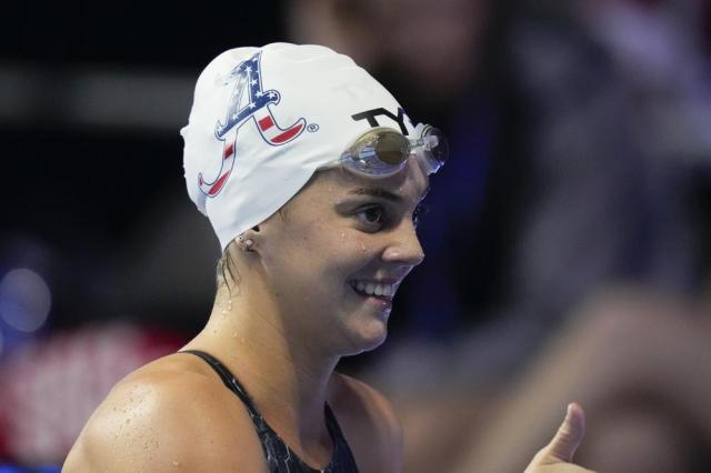 Rhyan White reacts after winning the women's 200 backstroke during wave 2 of the U.S. Olympic Swim Trials on Saturday, June 19, 2021, in Omaha, Neb. (AP Photo/Charlie Neibergall)