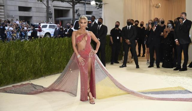 """Saweetie attends The Metropolitan Museum of Art's Costume Institute benefit gala celebrating the opening of the """"In America: A Lexicon of Fashion"""" exhibition on Monday, Sept. 13, 2021, in New York. (Photo by Evan Agostini/Invision/AP)"""