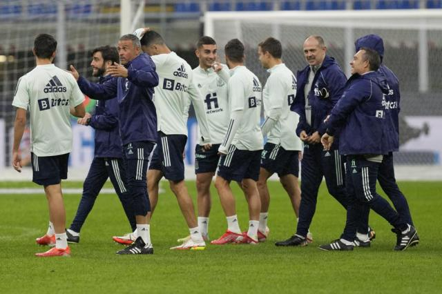 Spain's manager Luis Enrique, third from left, attends a training session ahead of Wednesday's UEFA Nations League semifinal soccer match between Italy and Spain, at the Milan San Siro stadium, Italy, Tuesday, Oct. 5, 2021. (AP Photo/Antonio Calanni)