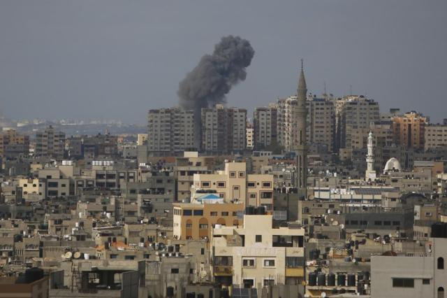 Smoke rises following Israeli airstrike, in Gaza City, Thursday, May 20, 2021. (AP Photo/Hatem Moussa)