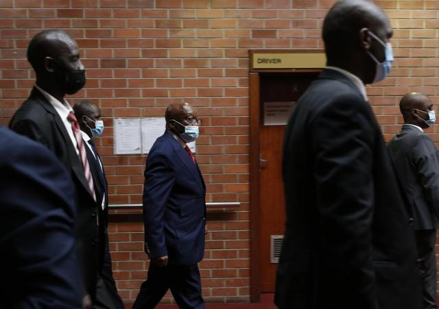 Former South African President Jacob Zuma, centre, arrives at the High Court in Pietermaritzburg, South Africa, Wednesday May 26, 2021. Zuma faces corruption charges alongside French arms company Thales dating back to 1999. (AP Photo/Phill Magakoe, Pool)